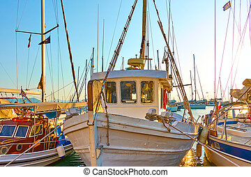 Fishing boats in the harbour in the evening