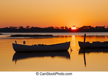 Fishing boats in the sunset