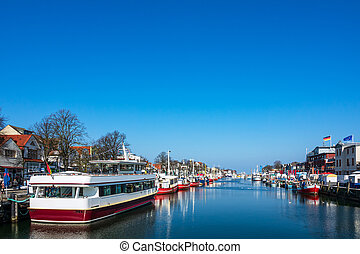 Fishing boats in winter time in Warnemuende, Germany.