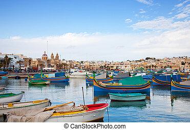 Fishing boats lying at Marsaxlokk Bay. Malta