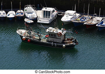 fishing boats moored at sea