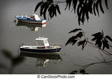 fishing boats moored in a beautiful calm bay