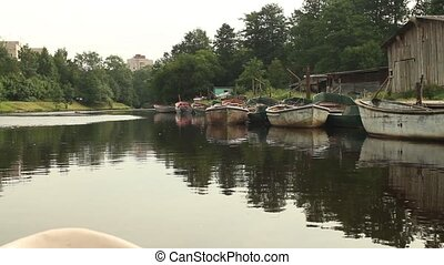 Fishing boats moored on the river