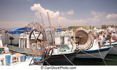 Fishing boats near the pier, boat parking, Parking of fishing ships, Pleasure boats and fishing boats in harbor