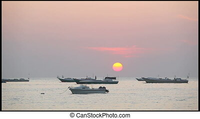 Fishing boats on a decline - A number of fishing boats...
