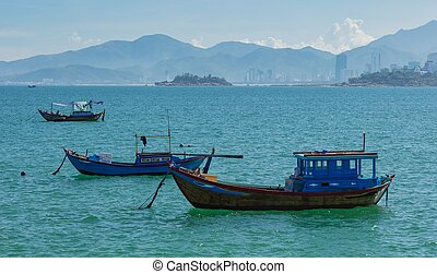 Fishing Boats On A Turquoise Ocean Vietnam