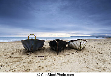 Fishing Boats on Bournemouth Beach - Fishing boats under a ...