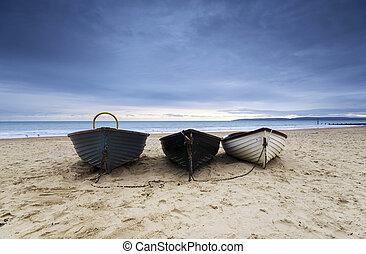 Fishing Boats on Bournemouth Beach - Fishing boats under a ...