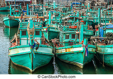 Fishing boats on cambodian coast - Old fishing boats in a...