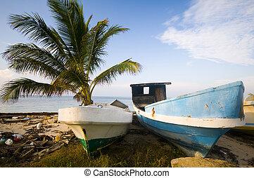 fishing boats on shore caribbean sea beach corn island ...