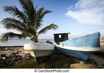 fishing boats on shore caribbean sea
