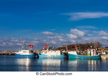 Fishing boats on shore of the Baltic Sea in Germany.