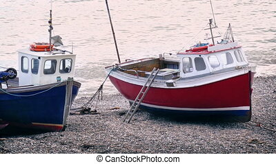 Fishing Boats On The Beach - Couple of fishing boats moored...
