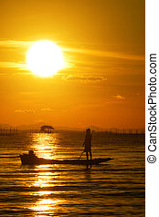 Fishing boats on the Black Lake. With sunset sky, thailand.