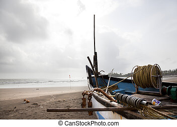 Fishing boats on the sand at the beach Patern in Goa