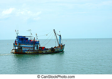 Fishing boats out to sea.
