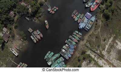 Fishing Boats parking on the river in Asia 4k Drone shot