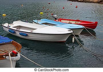 Fishing boats - Small fishing boats at anchor in small ...