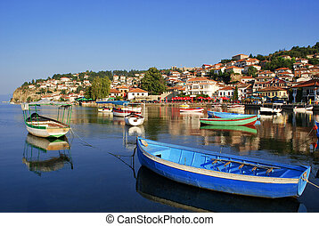 Ohrid - Fishing boats with the view of an old town of Ohrid ...