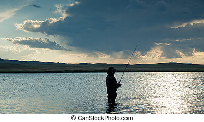 Fishing - Boy fishing at Eleven Mile Reservoir, Colorado.