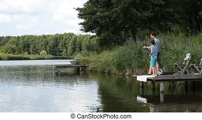 Fishing by the lake is our common passion. Happy father and...