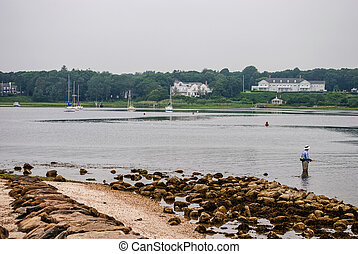 Fishing Cape Cod - A man wades in the water for some early...