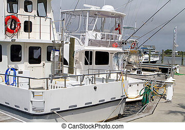 Fishing Charter Boats - Charter fishing boats sit idle at...