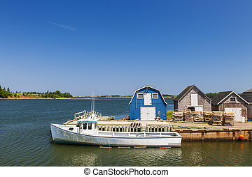 Fishing dock in Prince Edward Island Canada - Boat at...