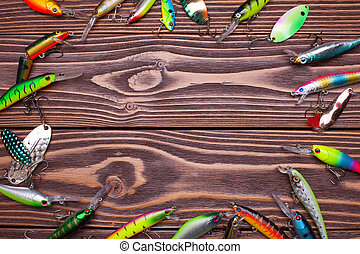 fishing frame - frame of fishing lures on a wooden...