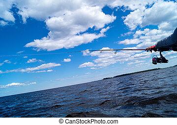fishing from a boat, Trolling fishing boat rod, sky scenery...