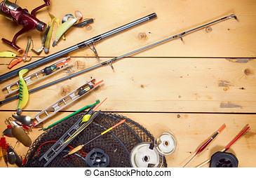 Fishing gears on wooden background