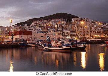 Fishing harbor of Los Cristianos at dusk. Canary Island Tenerife, Spain