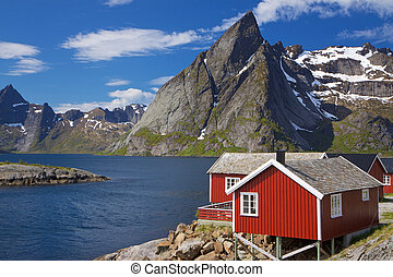 Fishing hut by fjord - Picturesque red fishing hut on the ...
