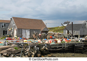 Fishing in Peggy's Cove - Fishing shacks with colorful buoys...