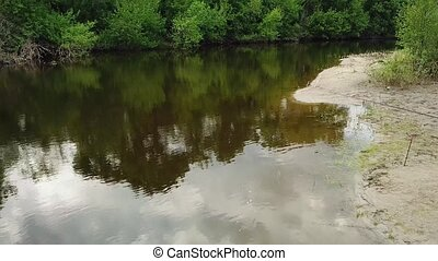 Aerial view of fisherman with a fishing rod on the river...