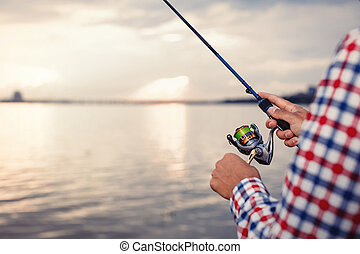 Fishing in the river at sunset.