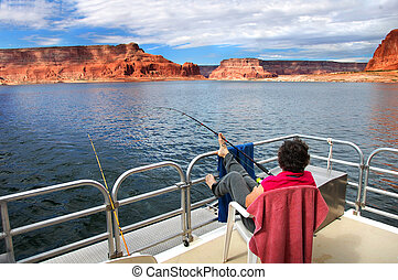 Fishing Lake Powell - Woman relaxes and enjoys the fantastic...