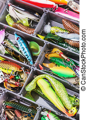 fishing lures and accessories in the box background