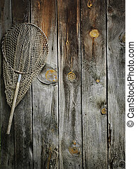 Fishing net - An old fishing net hanging on rustic wooden...