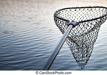 Fishing net over the lake at twilight