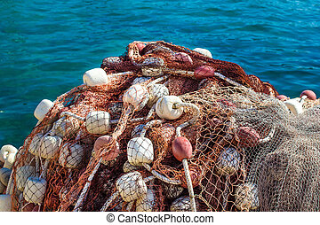 Fishing net pile by the sea