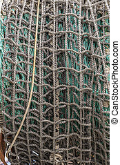 Fishing net rolled up on drum