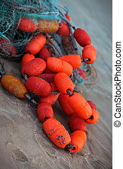Fishing net with bouys at the sea-shore - Fishing net with ...
