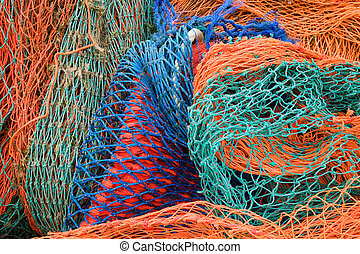 Close up of multi coloured industrial fishing nets.