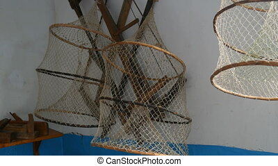 Fishing nets hang on the wall of the farmhouse.