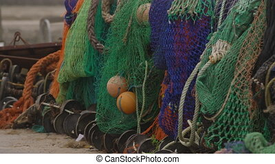 Fishing nets hanging up in a row - Close up of several ...