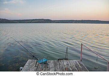 Fishing on a wooden pier.