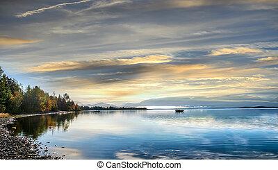 Fishing on an an Alaskan lake on the Kenai peninsula at sunrise