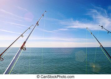 fishing on deep ocean under blue sky