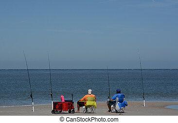 Fishing on Fernandina Beach, Cumberland Sound, Fort Clinch State Park, Nassau County, Florida USA